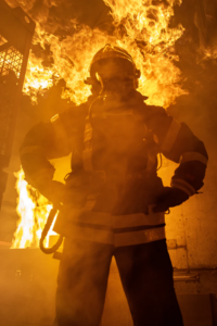 firefighter in front of flames